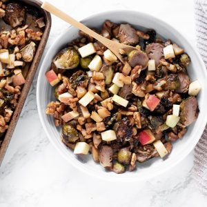 sweet and smokey honey roasted brussels sprouts with apples and walnuts whisk in wellness 3 featured