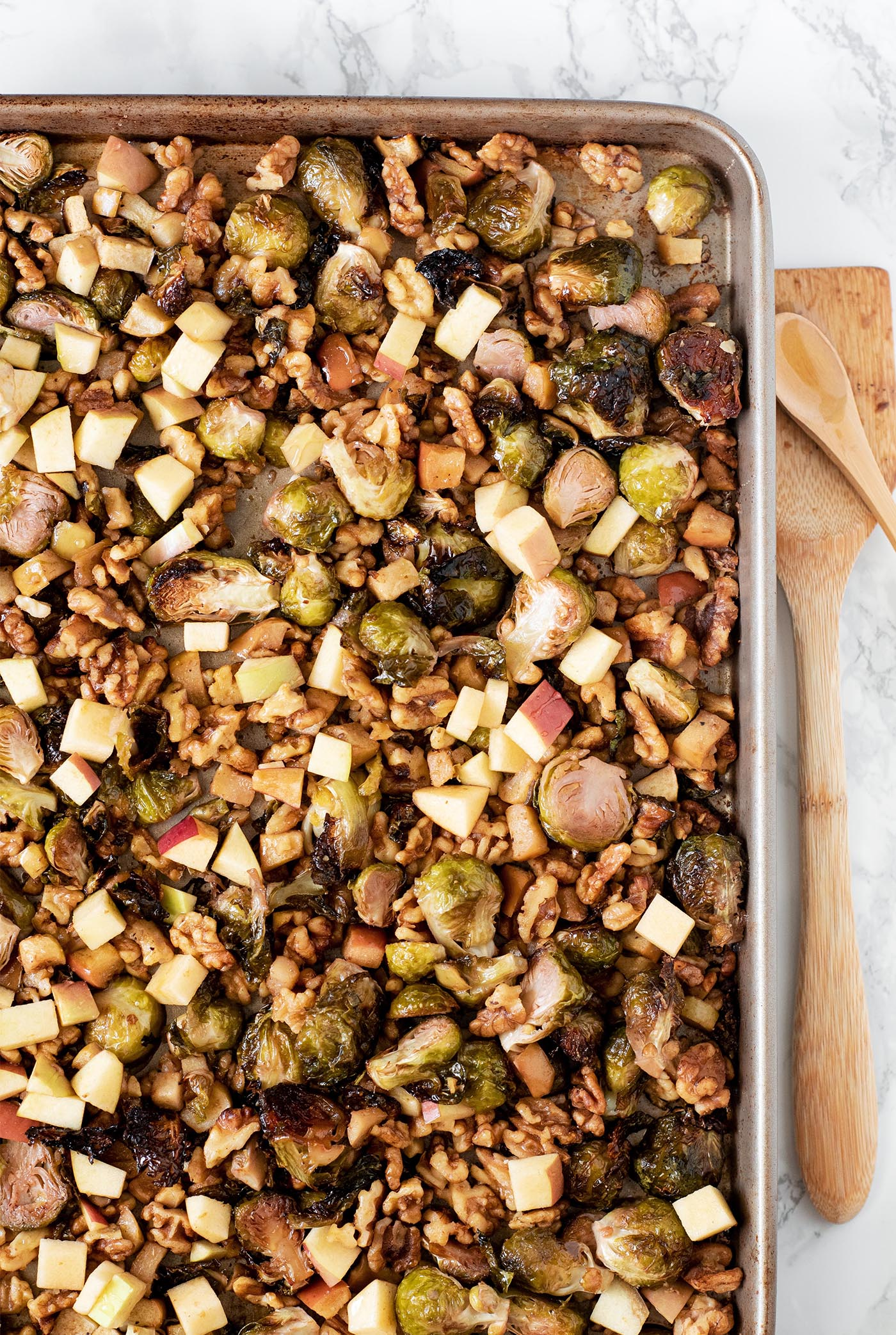 sweet and smokey honey roasted brussels sprouts with apples and walnuts whisk in wellness 4